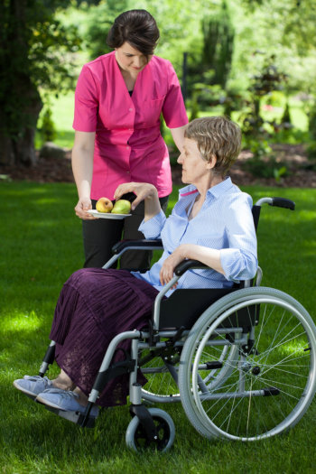Staff giving apples to patient